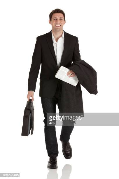 Happy businessman carrying a briefcase