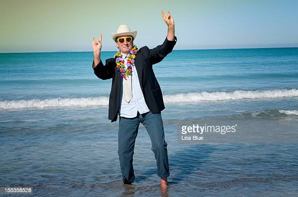 happy businessman dancing, miami beach - stereotypical stock pictures, royalty-free photos & images