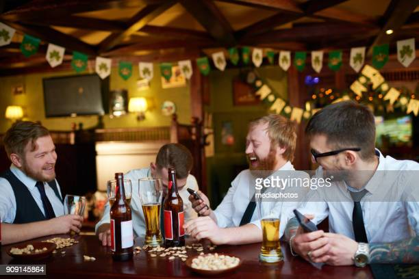 Happy businessman drinking tasty beer