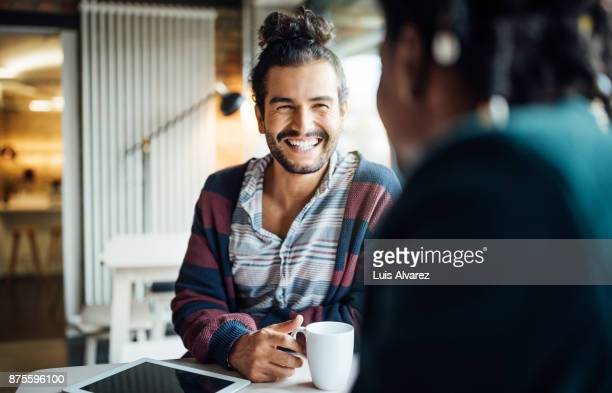 happy businessman having coffee with colleague - colega fotografías e imágenes de stock