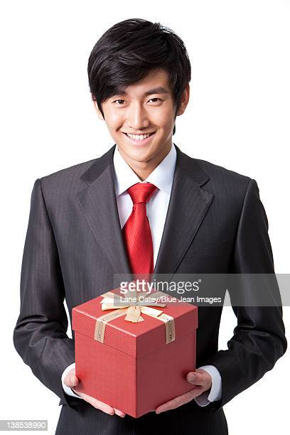 Happy Businessman Holding a Gift