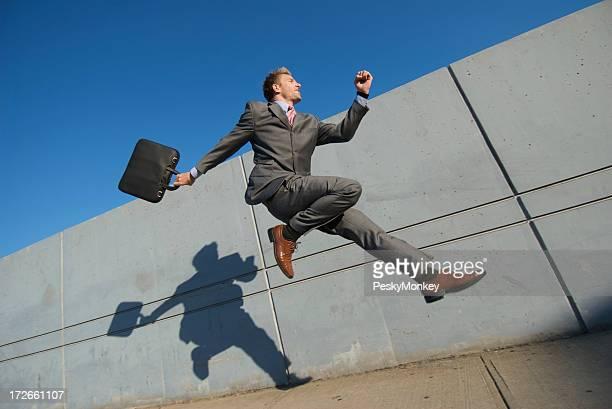 Happy Businessman Jumping City Sidewalk With Shadow