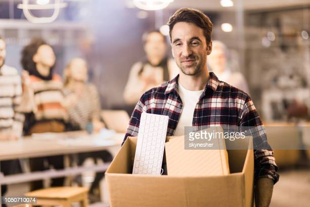 happy businessman leaving the office satisfied after quitting job. - quitting a job stock pictures, royalty-free photos & images