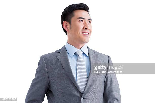 Happy businessman looking at view