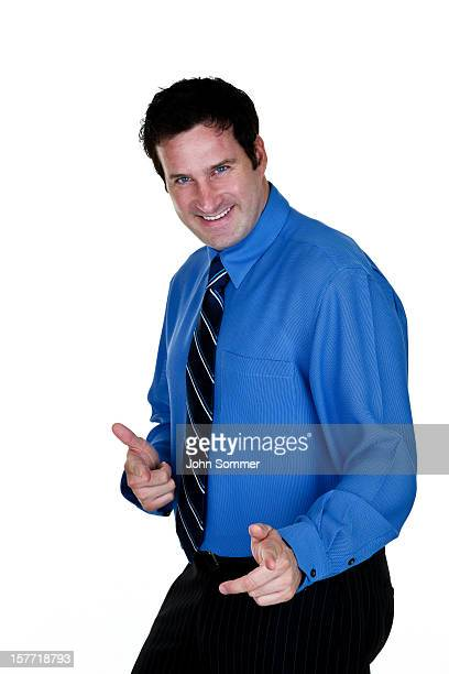 Happy businessman pointing at viewer