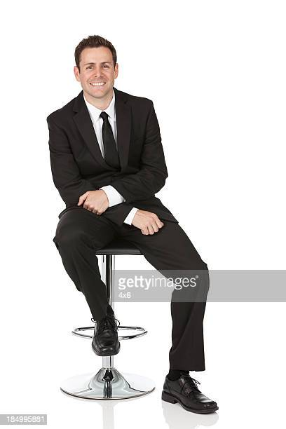 Happy businessman sitting on a chair