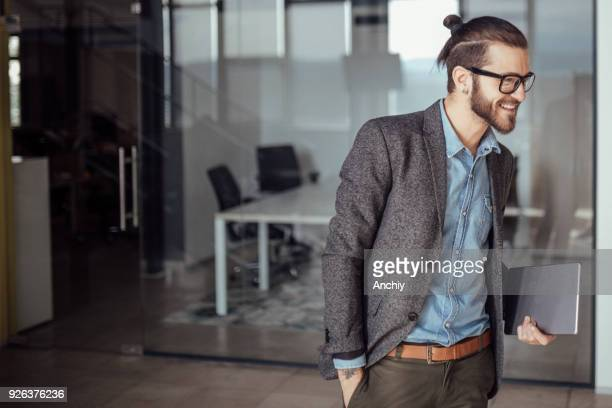 happy businessman smiling, copy space - man bun stock pictures, royalty-free photos & images