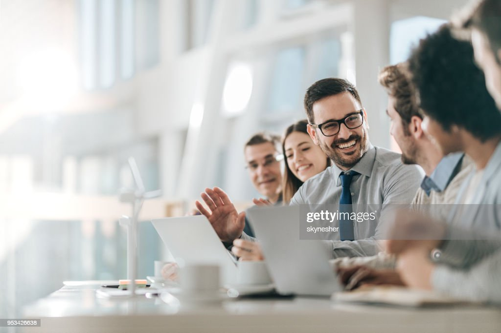 Happy businessman talking to his colleagues on a meeting in the office, : Stock Photo