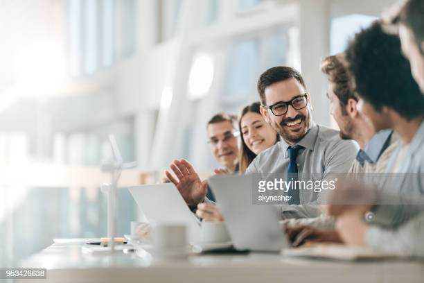happy businessman talking to his colleagues on a meeting in the office, - conference stock pictures, royalty-free photos & images