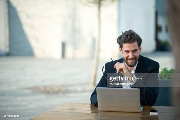 Happy businessman using computer