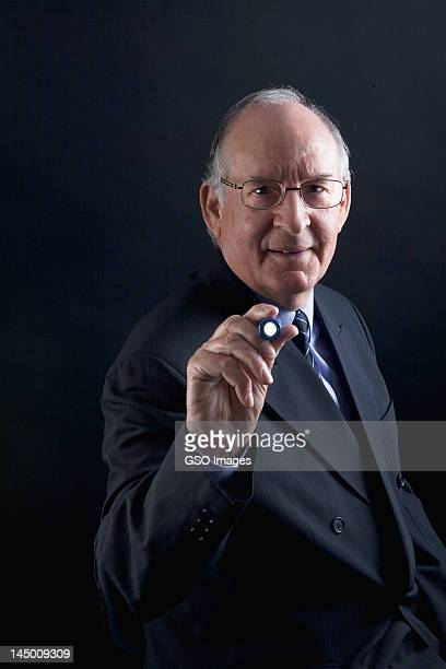 Happy businessman with a torch