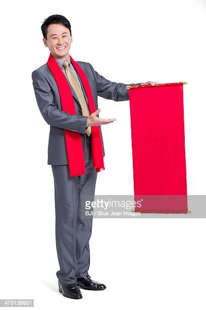 Happy businessman with blank scroll
