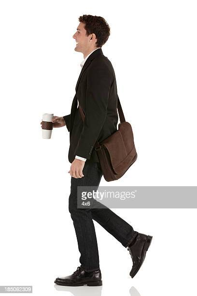 happy businessman with coffee - van de zijkant stockfoto's en -beelden
