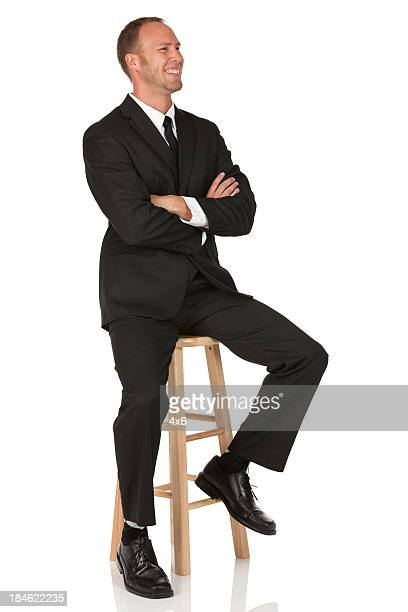 happy businessman with his arms crossed - stool stock pictures, royalty-free photos & images
