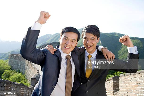 Happy businessmen on the Great Wall