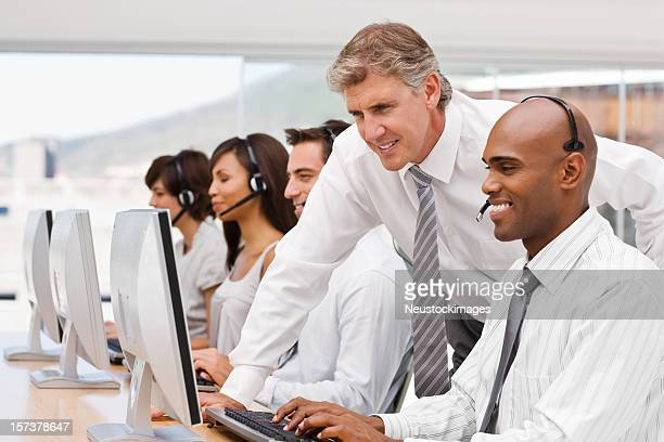 Happy businesspeople working on laptop