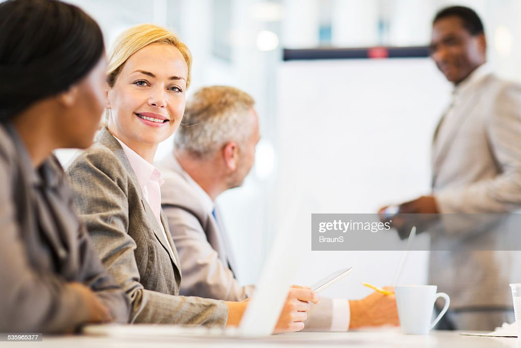 Happy businesswoman at meeting. : Stock Photo