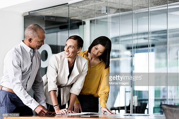 Happy businesswoman discussing with colleagues