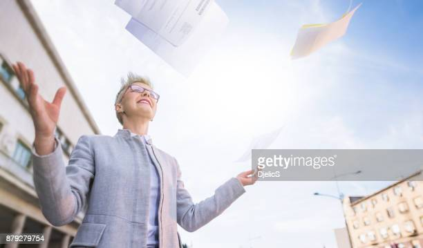 happy businesswoman feeling relieved and free. - throwing stock photos and pictures