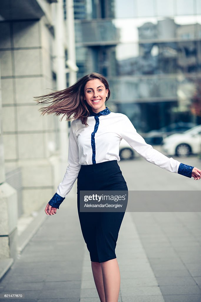 Happy Businesswoman how Dancing Outdoors on City Street : Stock Photo