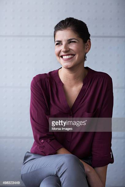 happy businesswoman in office - looking away stock pictures, royalty-free photos & images