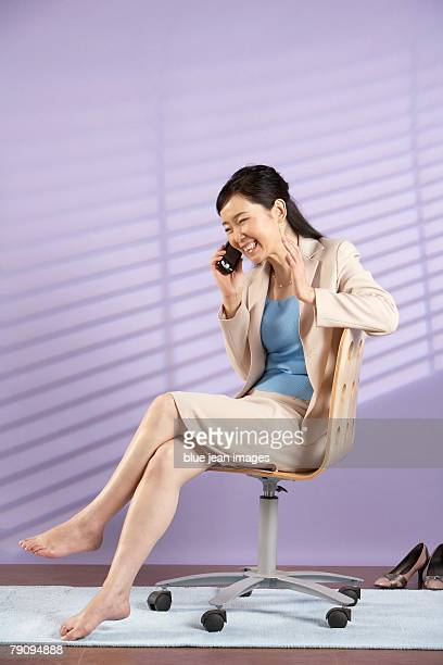 A happy businesswoman on a phone call.