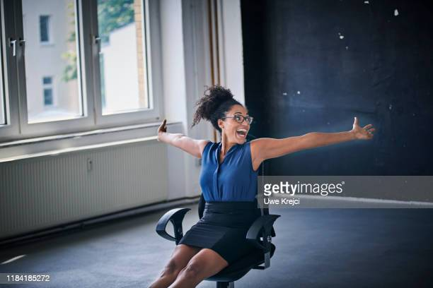 happy businesswoman - office chair stock pictures, royalty-free photos & images