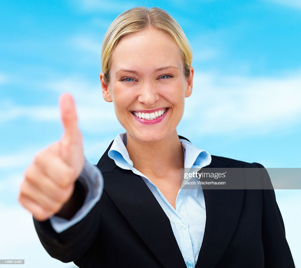 Happy businesswoman showing thumbs up sign : Stock Photo
