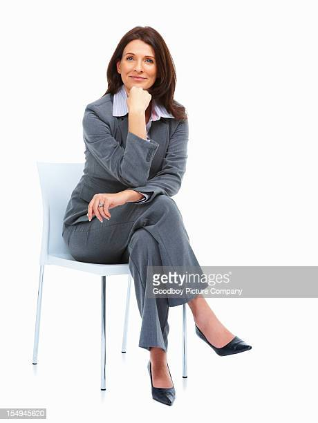 Happy businesswoman sitting on a chair