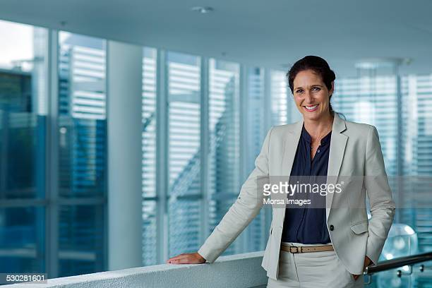 Happy businesswoman standing in office