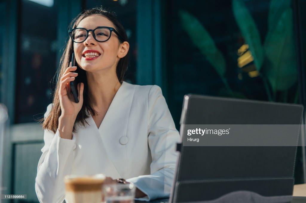 Happy Businesswoman Talking On Smart Phone Stock Photo
