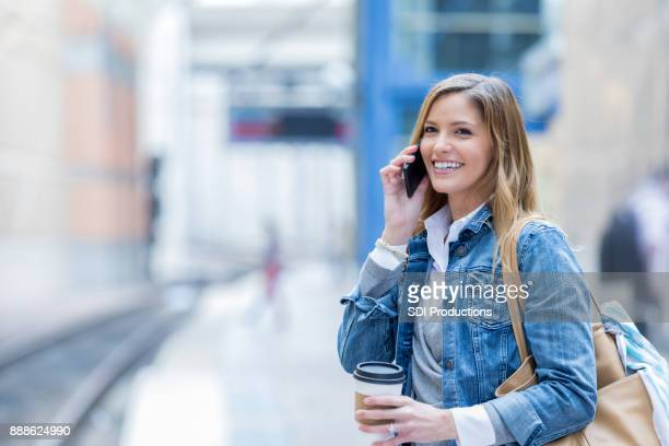 Happy businesswoman waiting for train