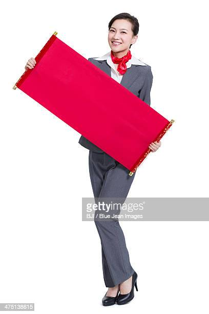 Happy businesswoman with blank scroll
