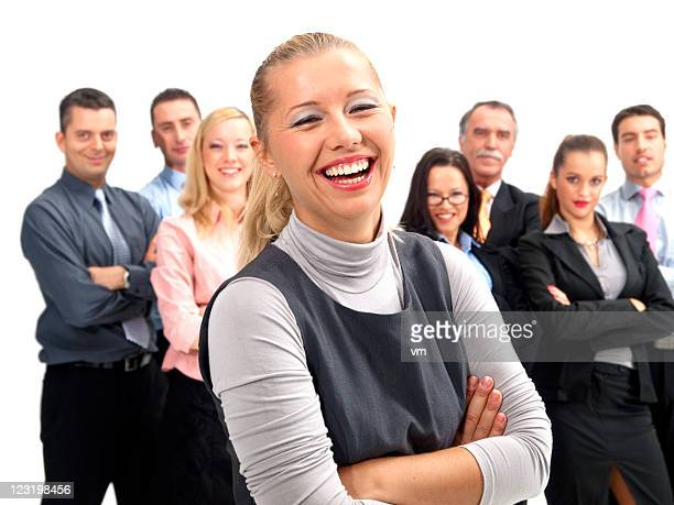 Happy businesswoman with her team in the background.