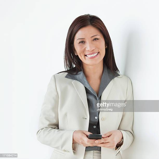 Happy Businesswoman With Mobile Phone - Isolated.
