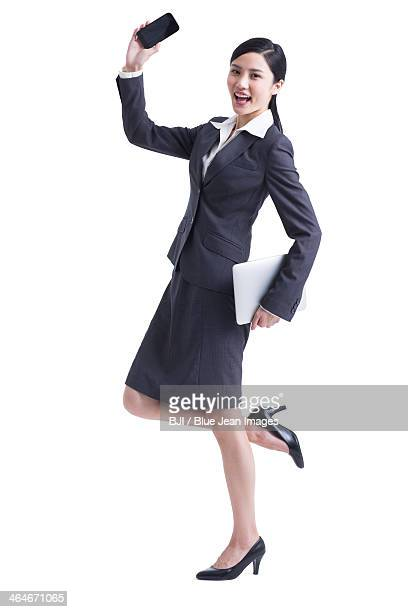 Happy businesswoman with smart phone and digital tablet