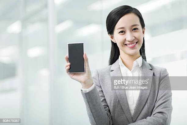 Happy businesswoman with smart phone
