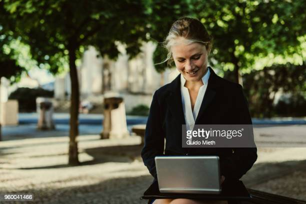 Happy businesswoman working with tablet pc.