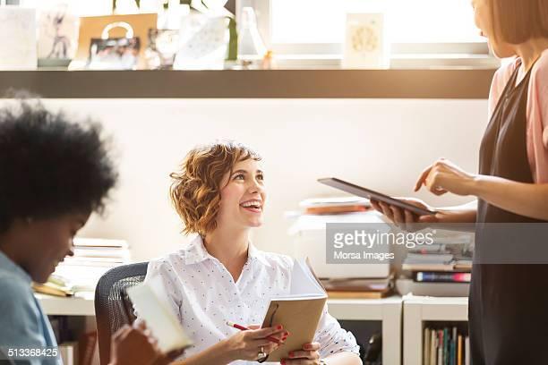 Happy businesswomen discussing in office