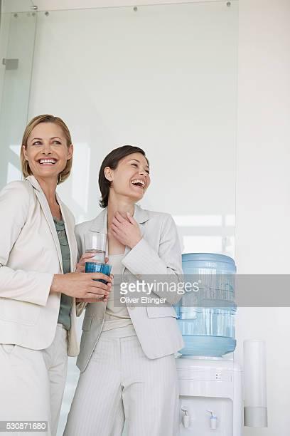 happy businesswomen - oliver eltinger stock-fotos und bilder