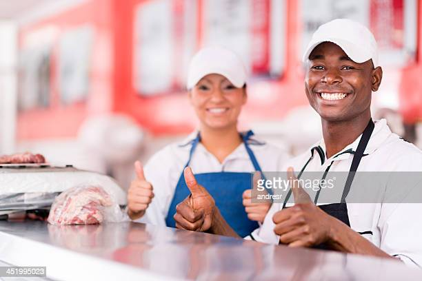 Happy butchers shop owners