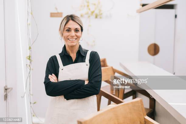 happy cafe manager - one mature woman only stock pictures, royalty-free photos & images
