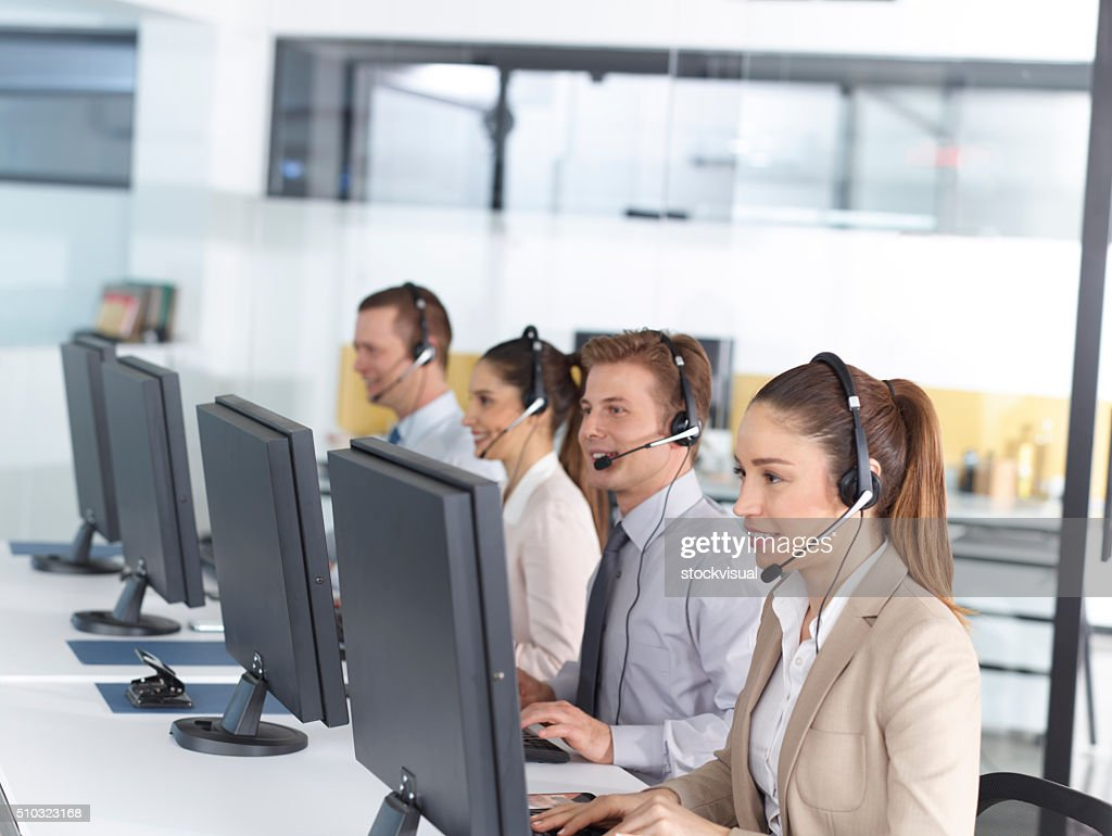 Happy call center operators : Stock Photo