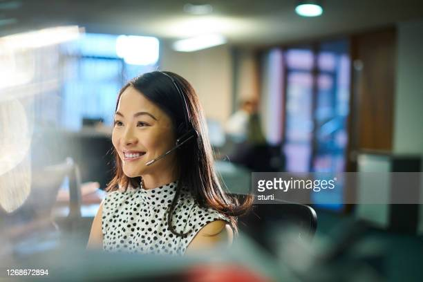 happy call handler - east asian ethnicity stock pictures, royalty-free photos & images