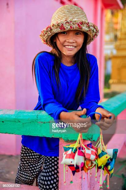 happy cambodian little girl selling souvenirs, cambodia - traditionally cambodian stock pictures, royalty-free photos & images