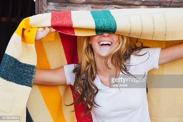 happy camper covering eyes with hudson bay blanket - hudson bay stock photos and pictures