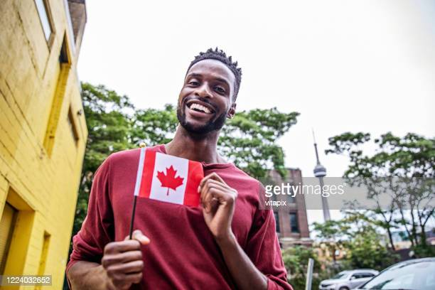 happy canadian man - canada day stock pictures, royalty-free photos & images