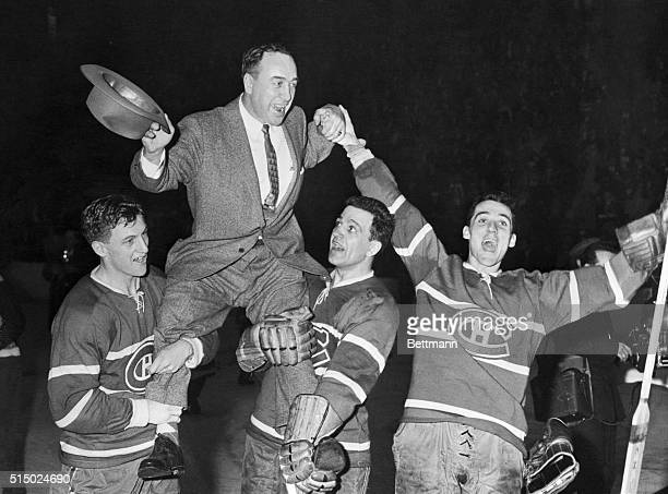 Happy Canadiens hoist their coach after 31 victory over Red Wings From left Dickie Moore Boom Boom Geoffrion and Henri Richard hold coach Hector Toe...