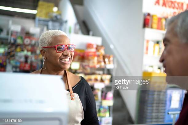 happy cashier working at wholesale - convenience store stock pictures, royalty-free photos & images
