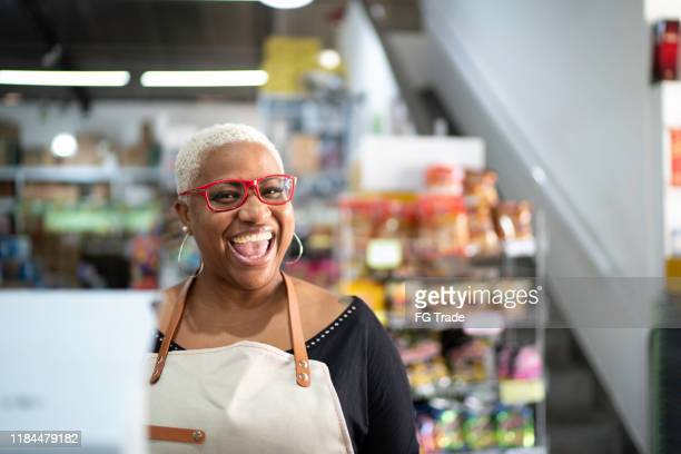 happy cashier working at wholesale - market retail space stock pictures, royalty-free photos & images